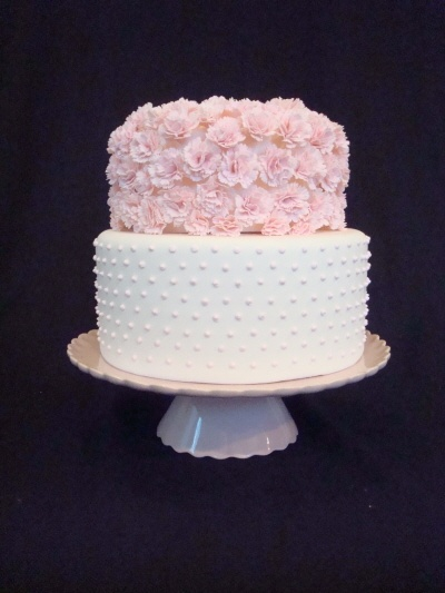 Pink carnations and pearl wedding cake