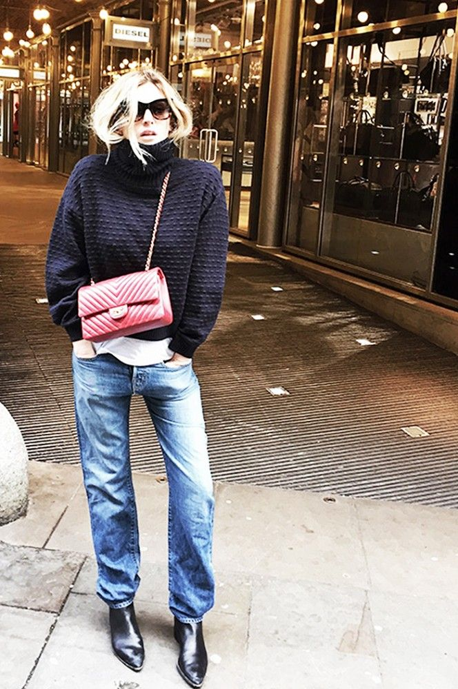 Camille Charrière of Camille Over the Rainbow masters the laid-back cool-girl look in a chunky knit, baggy jeans and bold red purse