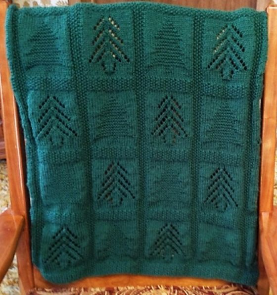Free Knitting Pattern for Pine Tree Blanket - Garter and lace pine trees with a moss stitch border. Designed byAlice Kalush