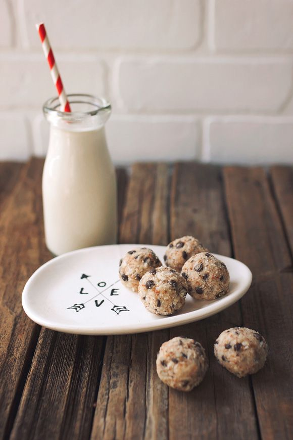 Edible Earth Day: Cookies and Milk, the Healthy Way.   Save on packaging and waste by making your own Almond Milk, then use the leftover pulp to create these Chocolate Chip Cookie Dough Balls // @tastyyummies // www.tasty-yummies.com