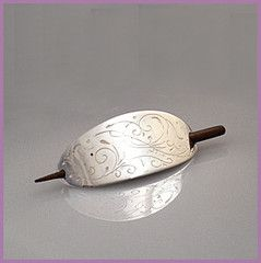 'Sugarbird' hair barrette: - A hand finished sterling silver hair slide, a beautiful accessory for pinning up long hair, with gentle line work reminiscent of a sugarbird sipping nectar. A handmade black walnut pin secures this hair slide in your hair. Each hair slide is engraved on the back with its own unique registration number. Price: $93.45 - Buy at http://mosadijewelry.com/collections/mosadi-jewelry-hairpins/products/sugarbird-sterling-silver-hair-barrette