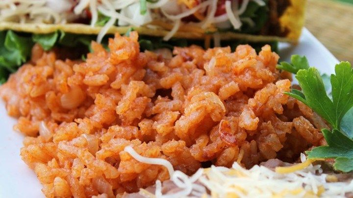 Rice is cooked with cumin and onion, then simmered with tomato sauce and chicken broth for this restaraunt-inspired Mexican rice recipe.