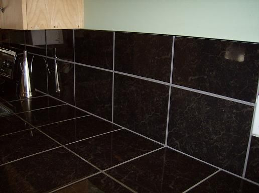 Black Tile Kitchen Counter With Gray Grout