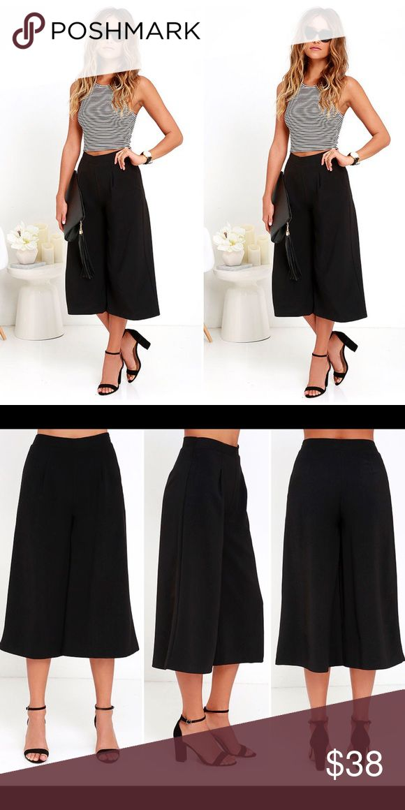 """LULU'S FASHION WEEKEND BLACK CULOTTES These wear-anywhere gauchos are made from soft woven fabric with a high waist and darted details. Chic, wide-cut pant legs. Hidden side zipper with clasp. Unlined. Self: 97% Polyester, 3% Spandex. Lining: 100% Polyester Fit: This garment fits true to size. Length: Mid-calf length. Size small measures 31"""" from top to bottom. Inseam: 19.5"""" Front Rise: 12"""" Waist: Fitted - very fitted at natural waist. Hip: Not Fitted - room for hips. Fabric: Fabric has no…"""