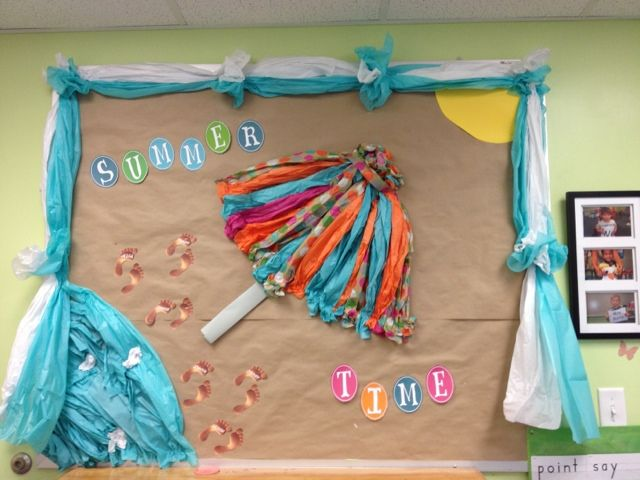 Summer Bulletin Board for Summer School Session. The footprints have each students' name on them