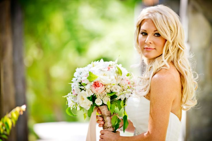Lovely antique golden compotes held romantic garden blooms such as Juliet garden roses, lavender hydrangea, white clematis, and scabiosa flowers to name a few. Photos:True Photography. Wedding Coordinator Crown Weddings. Florals: Adorations Botanical Artistry.