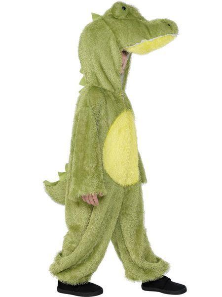 Lasten Naamiaisasu; Krokotiili. Krokotiilin hirmuinen naamiaisasu. Vaikka oikeasti krokotiilit liikkuvatkin matelemalla, niin tämä naamiaisasuinen yksilö kulkee sujuvasti myös kahdella jalalla.