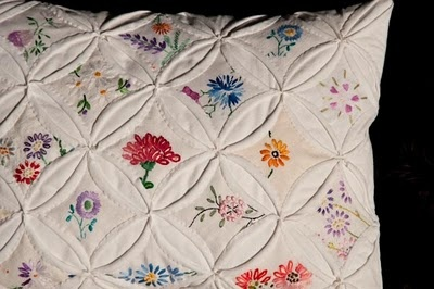 Cathedral Window Pillow---antique embroidery pieces for the center.    AMAZING!!   Adding this to my must make list