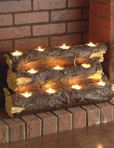Great for an unused fireplace ! My husband's next project. Diy home decor on a budget. FIREPLACE INSERT CANDLE LOG