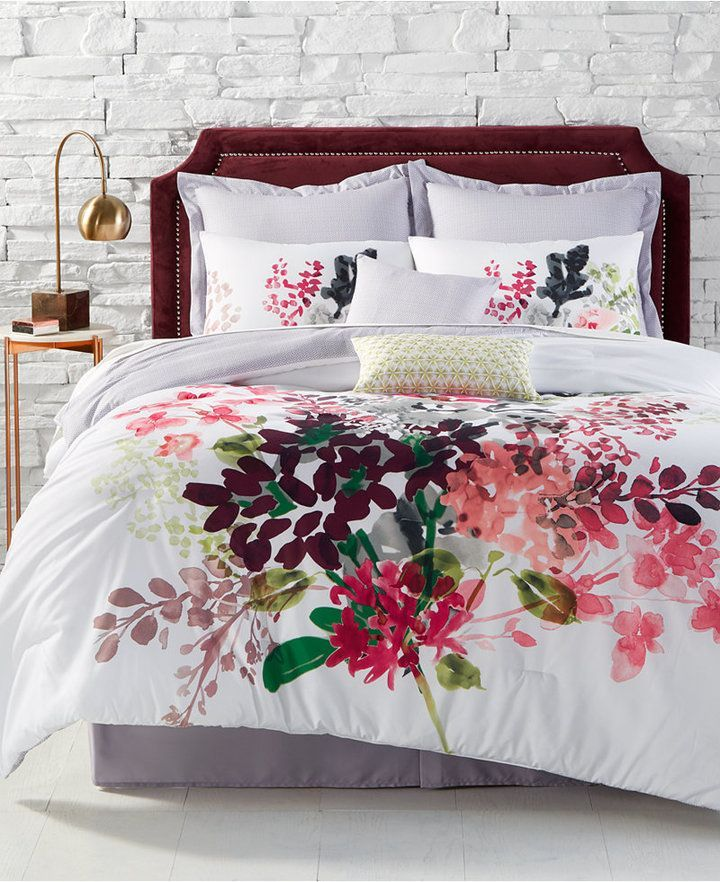 Bouquet Reversible 8-Pc. Queen Comforter Set  Beautify any bedroom with the colorful blossoms and geo-print reverse of these Bouquet comforter sets. The coordinating decorative pillows and shams take your ensemble to a whole new level of style and comfort.