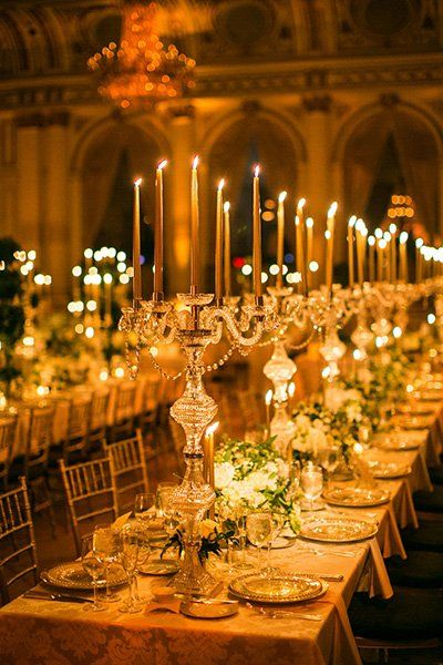 Draw inspiration from Beauty and the Beast with beautiful candelabras lining a gold-accented table.
