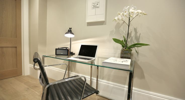 Work space at 56 Welbeck Street, London, complete with an original art print.