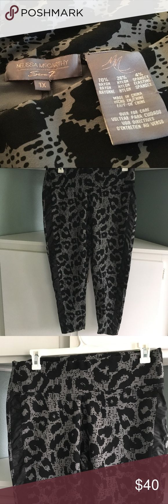 Melissa McCarthy by Seven 7 Leggings Awesome black and grey leopard spotted leggings. Leather looking strips down the side of each leg. These are a heavier material made really well. The waist has a thick band to make you look great! The back is designed to shape you nicely. NWOT bought them for my daughter and never returned. (She didn't like the band at the waist). Melissa McCarthy Pants Leggings
