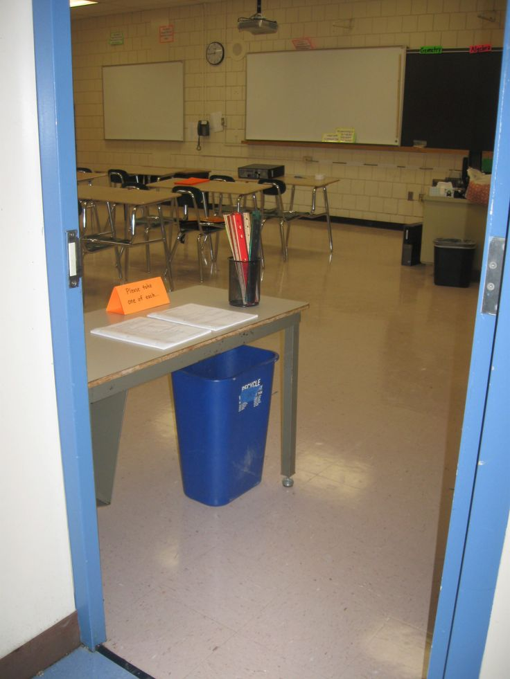 Entrance table from a high school maths room --- students collect all worksheets and  equipment as they walk in. Would be interesting to adapt for primary school.
