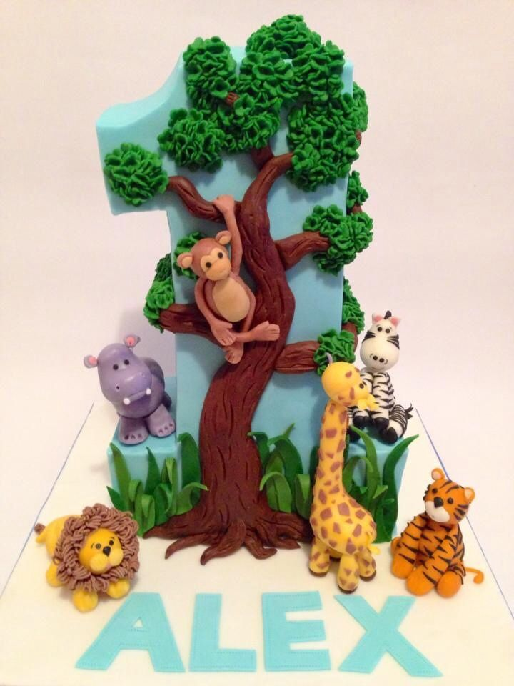 - I made this cake for my son's first birthday. The theme of the cake is based on a jungle puzzle that he enjoys a lot. I thought a standing no. 1 would look much better than a flat one. I have also made cookies to match the cake, as giveaways for the guests :)