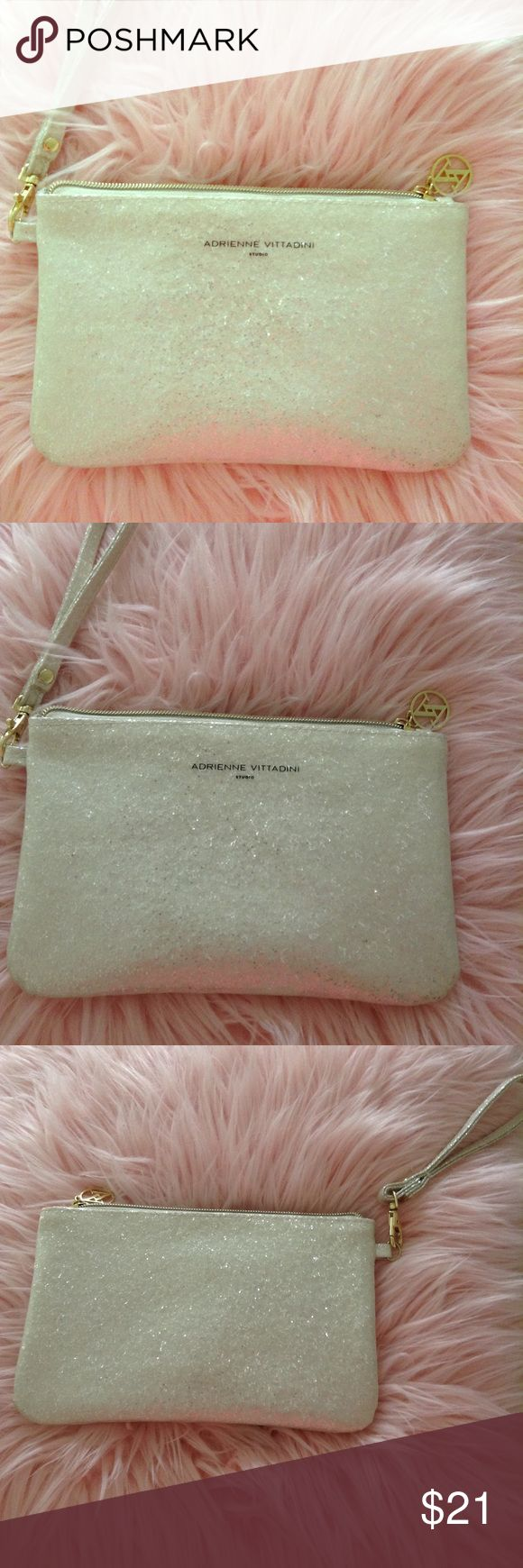 White Sequin Clutch White Sequin clutch with built in phone charger. Like-new, used once for a special event. Adrienne Vittadini Bags Clutches & Wristlets