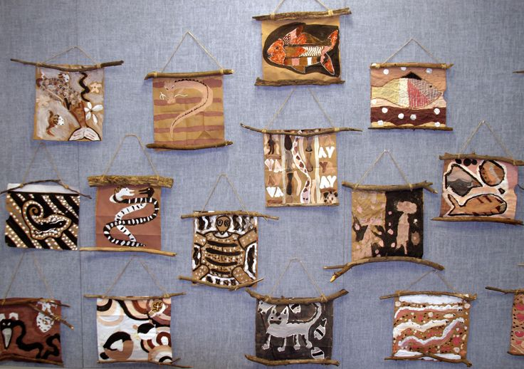 Aboriginal Australian bark painting....love the way these are hung!