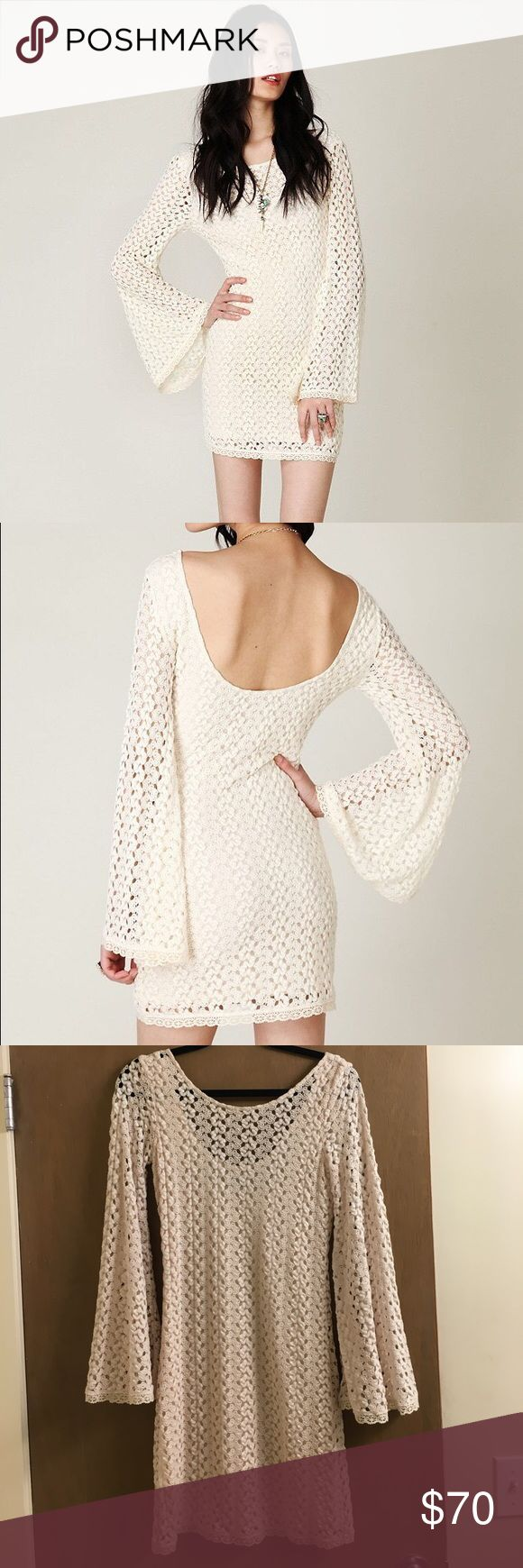 Free People crochet dress A crochet form fitting dress with bell sleeves that gives off a 70's feel and is perfect for a comfortable night out Free People Dresses Mini