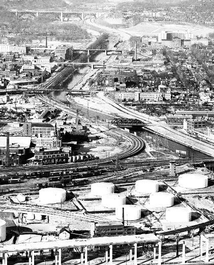 February 1953 as work progressed on the new Don Valley Pkwy. Looks north. We see various bridges that cross the Don. From the bottom to the top of the photo are the Eastern Ave. bridge (closed to all traffic when the Don Valley Pkwy. built), the Queen St. bridge (built in 1909-11 to eliminate a dangerous at-grade railway crossing), the Dundas St. bridge, the Gerrard St. bridge, the pedestrian foot bridge at Riverdale in the distance the Don Valley section of the majestic Prince Edward…