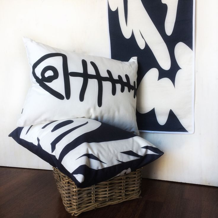 Fish throw pillows... a bit of nautical, a bit of summer in your home. In black on white, or white on navy.