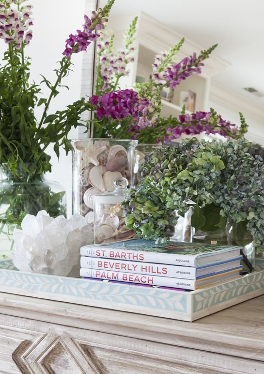 In Good Taste: Sam Allen - Design Chic - nothing quite like a fresh flower arrangement and a beautiful bone inlay tray on a chest in the living room