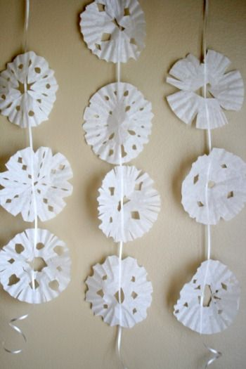 holiday preschool craft.  coffee filter snowflakes on a string.  Add watercolors for extra color.