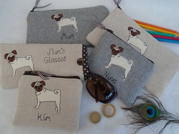 Here we have a delightful handmade personalised coin/card purse/ small cosmetic bag or pencil case made using beautiful Laura Ashley oatmeal linen or grey wool. It has an appliqued and embroidered pug dog with a choice of backing fabric and a choice of wording or name (up to 15 characters). If you would like extra wording other than the 15 characters, please contact me, as, for an extra charge I can embroider more words on the back. The coin purse measures approx 12x10cm and the pen...