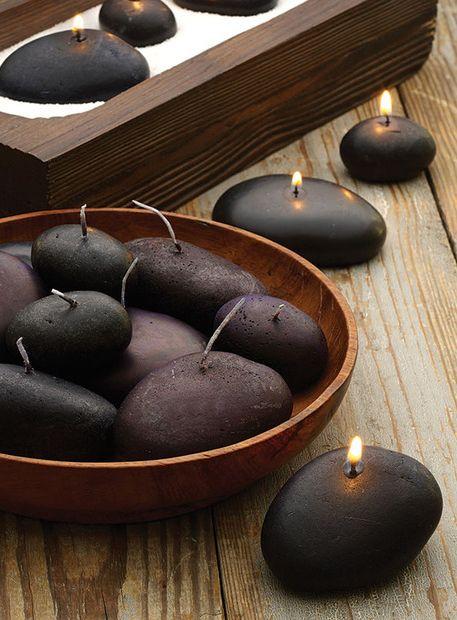 River rocks candles.
