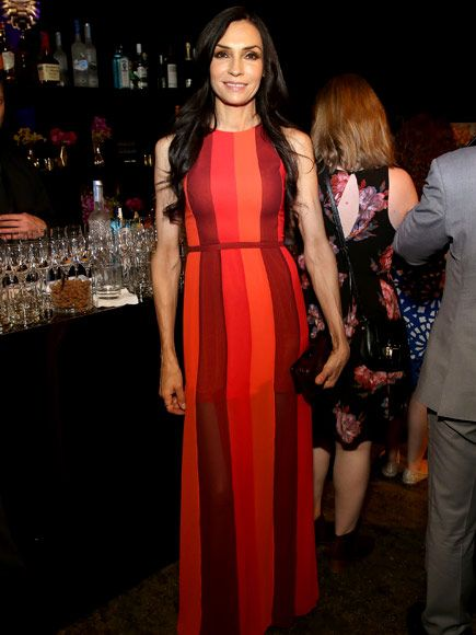See Your Favorite Stars Celebrating at the PEOPLE & Entertainment Weekly Upfronts Party | FAMKE JANSSEN | The red hot actress can't help but smile now that she's headlining NBC's spinoff series The Blacklist: Redemption.