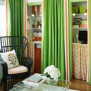 BHG - living rooms - apple green, granny smith apple green, green and orange, green and orange curtains, green and orange drapes, hidden office, office nook, hidden office nook, green and orange office, orange and green office, skirted table, skirted desk, geometric skirted desk, geometric skirted table, orange skirted desk, orange skirted table, orange geometric skirted desk, orange geometric skirted table, acrylic coffee table, black office chair, black wicker office chair, green door…