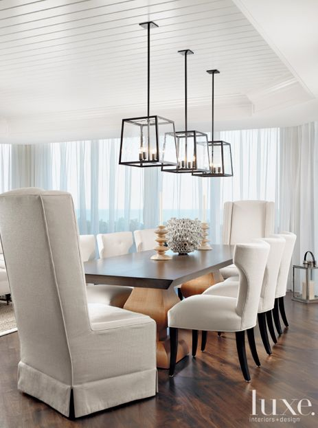 In this stunning dining room, three Holly Hunt light fixtures are suspended over a rectangular table: Dining Rooms, Hunt'S Lights, Lights Fixtures, Light Fixtures, Stunning Dining, Rooms Lights, Holly Hunt'S, Rectangular Tables, Three Holly