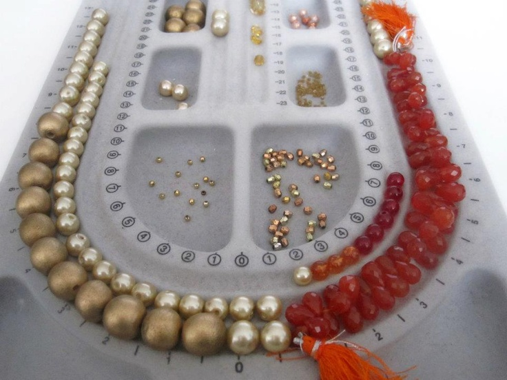 Starting on the ultimate bold summer necklace in tangerines and gold!  Carnelian that is the perfect Tangerine Tango color, wood, glass pearls and perspex.  And some info on the main stone: A stabilising stone, Carnelian restores vitality and motivation, and stimulates creativity. It gives courage, promotes positive life choices, dispels apathy and motivates for success.