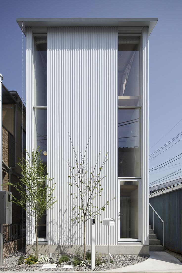 Tall and thin, corrugated cladding, urban site