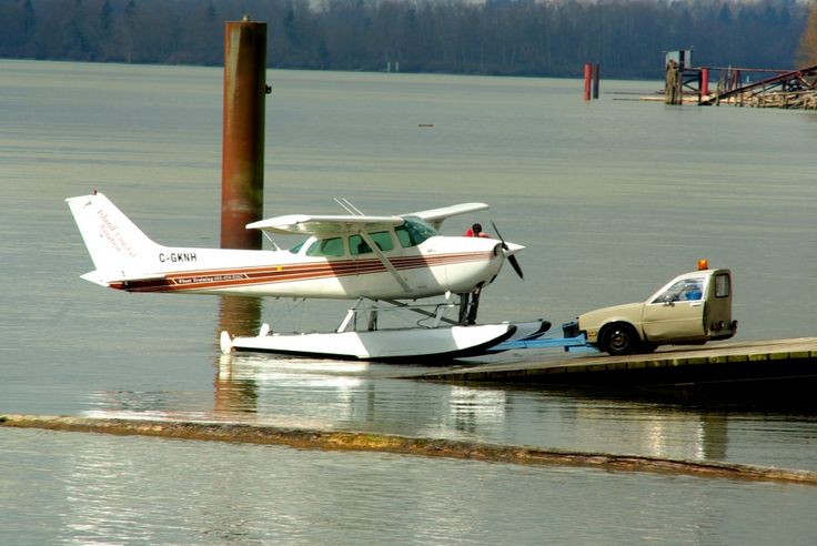 A photo of an Island Coastal Aviation Cessna 172 float plane at Pitt Meadows airport (CYPK / YPK). The aircraft registration is C-GKNH