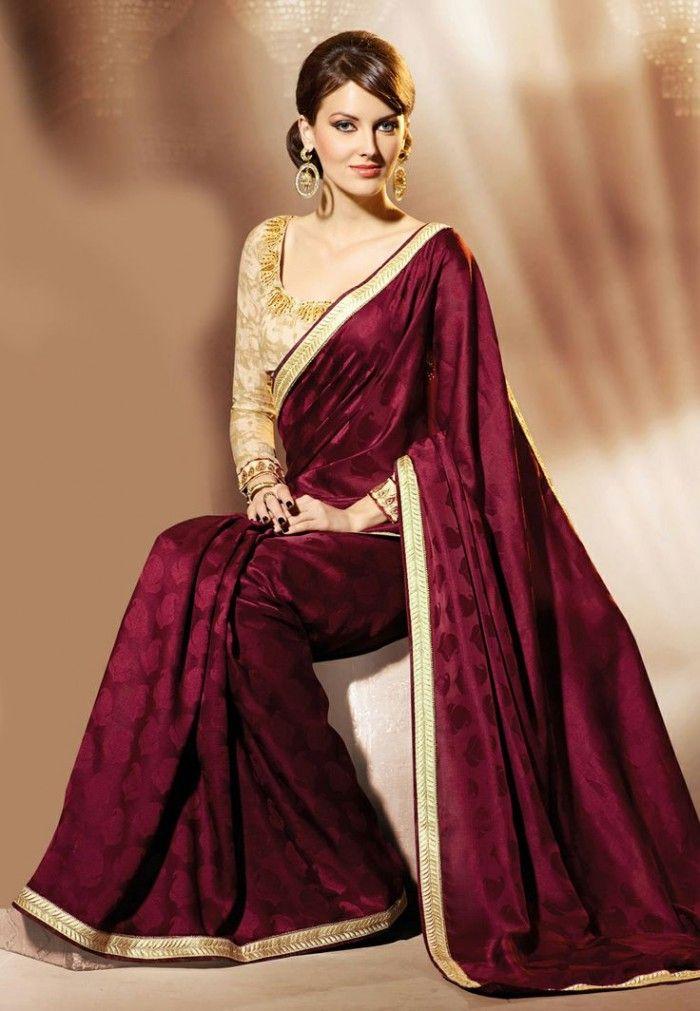 Maroon colour satin jacquard saree with gold border and blouse