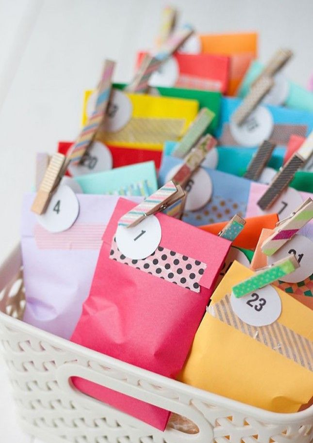 Use bright printer paper to fold up a basket full of treat bags for this colorful advent calendar.