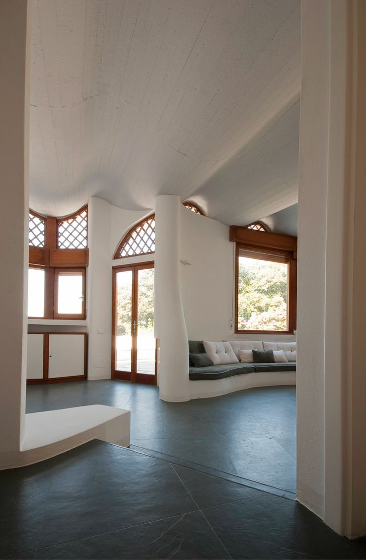 Wow so beautiful!  Love the details like the ledge next to the stair step and the ceiling molded around the rafters for that wavy look... oh and the wood trimmed windows! Tellaro home beauty space