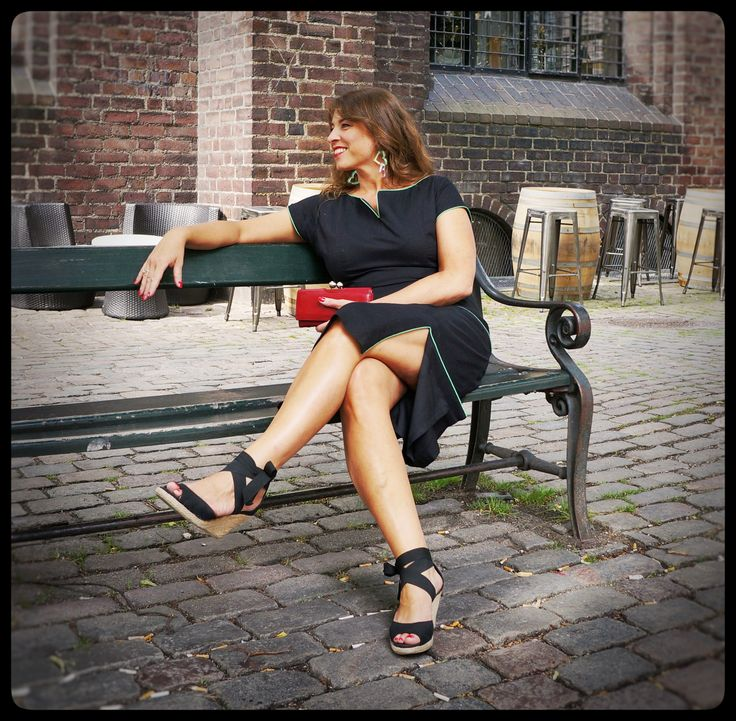 """In love with my City! Enjoying the weekend in the old streets of Copenhagen. Outfit of the day - Wearing my Black """"Connie"""" dress."""