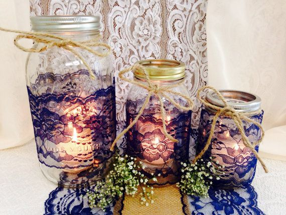 Love this idea for centrepieces!! at https://www.etsy.com/listing/185935162/navy-blue-lace-mason-jar-lace-4-inch