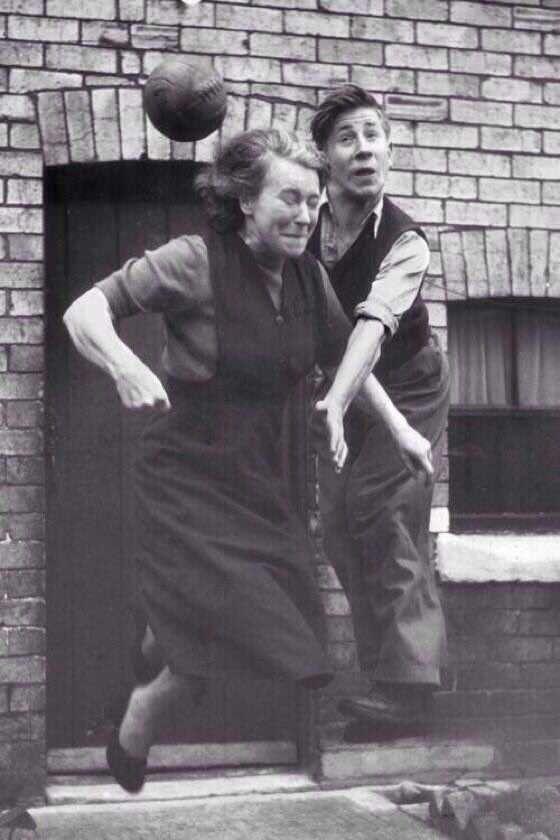 Bobby Charlton(Man Utd England) practicing his heading with his mother Elizabeth outside their home 1953