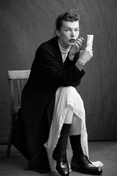 Milla Jovovich wears a long black Giorgio #Armani wool coat.