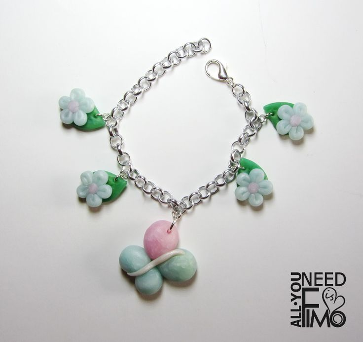 Bracelet with fimo pendants representing rose quartz, ice crystal mother of pearl and jade green effect butterfly and daisies INFO: https://www.facebook.com/AllYouNeedIsFimo/photos/a.937250929688782.1073741828.932013750212500/1045670472180160/?type=3&theater \/ #fimo #polymerclay #artigianato #fattoamano #handmade #jewelry #gioielli #etsy #etsyshop #allyouneedisfimo #fimocreations #bracciale #bracelet #farfalla #butterfly #fiori #flowers #daisies #margherite #rosequartz #icecrystals…