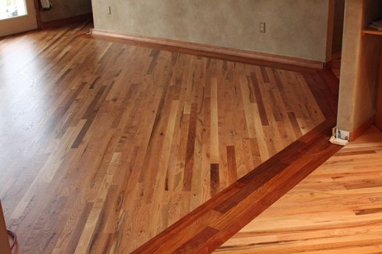 Two Different Wood Floors In House With Simple Border