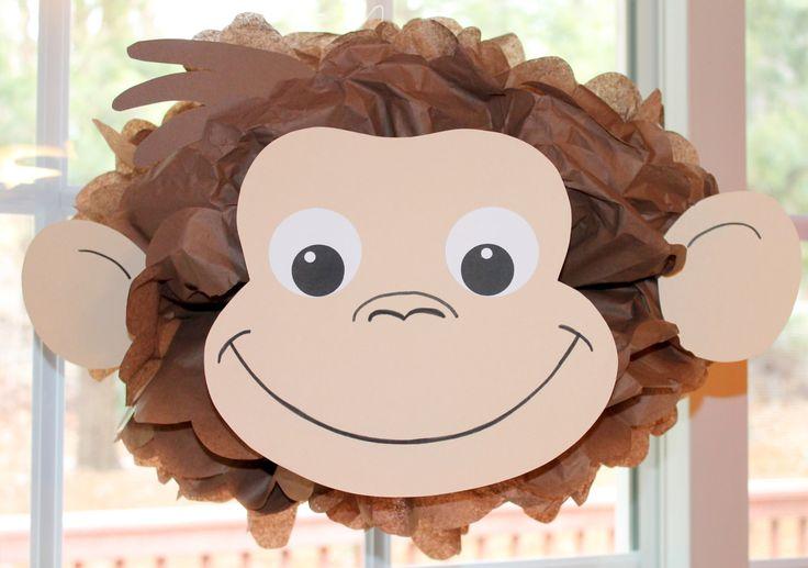 Curious George monkey inspired pom pom kit baby shower first birthday party decoration. $9.99, via Etsy.