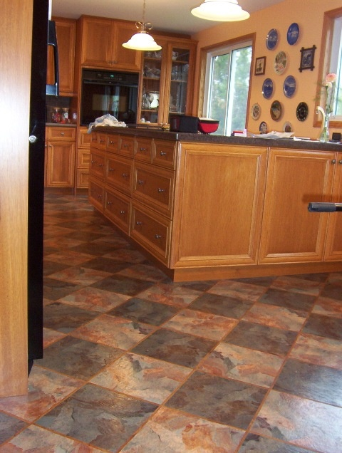 Vinyl Flooring...impressed that it's vinyl, and I like the diagonal trend. Also like the honey cabinets with dark tops.  (Link doesn't work, tho)
