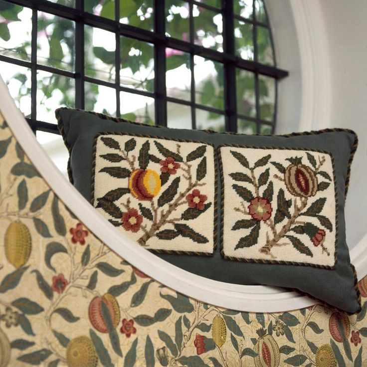 Peach and Pomegranate needlepoint designs on a single cushion, based on the William Morris wallpaper.
