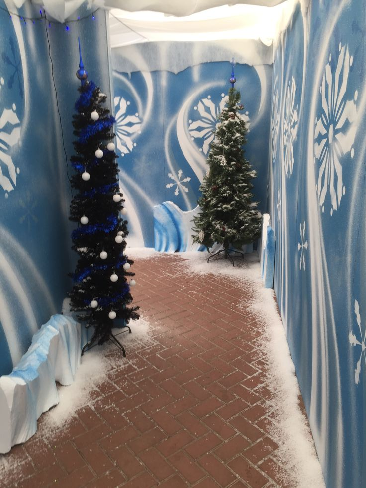 One of the magical walkways through a Christmas grotto, filled with snow and lined with Christmas trees.