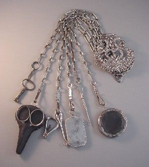 """1850 cut steel sewing chatelaine with 7 implements, 16-1/2"""" total length. The implements include a key, scissors with case, tiny corkscrew, aide memoire, sewing awl and round pin holder.: Steel Sewing, Victorian 1850, 1850 Cut, 1850S, Cut Steel"""