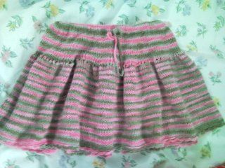 This Easy Summer Toddler Skirt is perfect for any adventurous toddler. Knit in the round, this easy skirt is composed of knit and purl rows. To finish the skirt off, you can either create a crochet edge or knit five more rows of the garter stitch.
