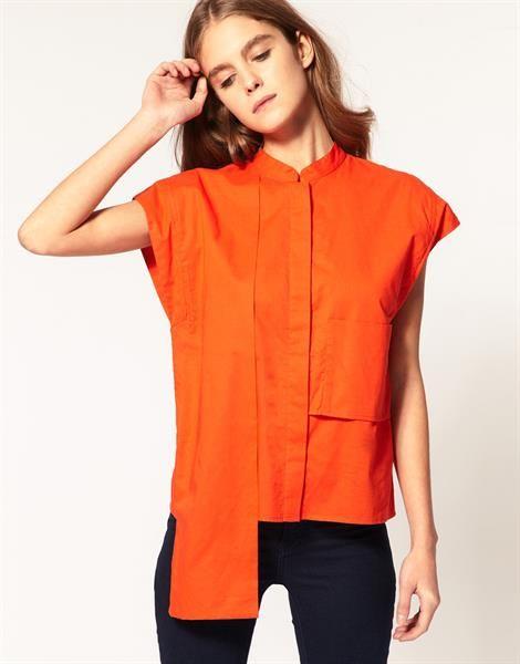 Женская оранжевая рубашка